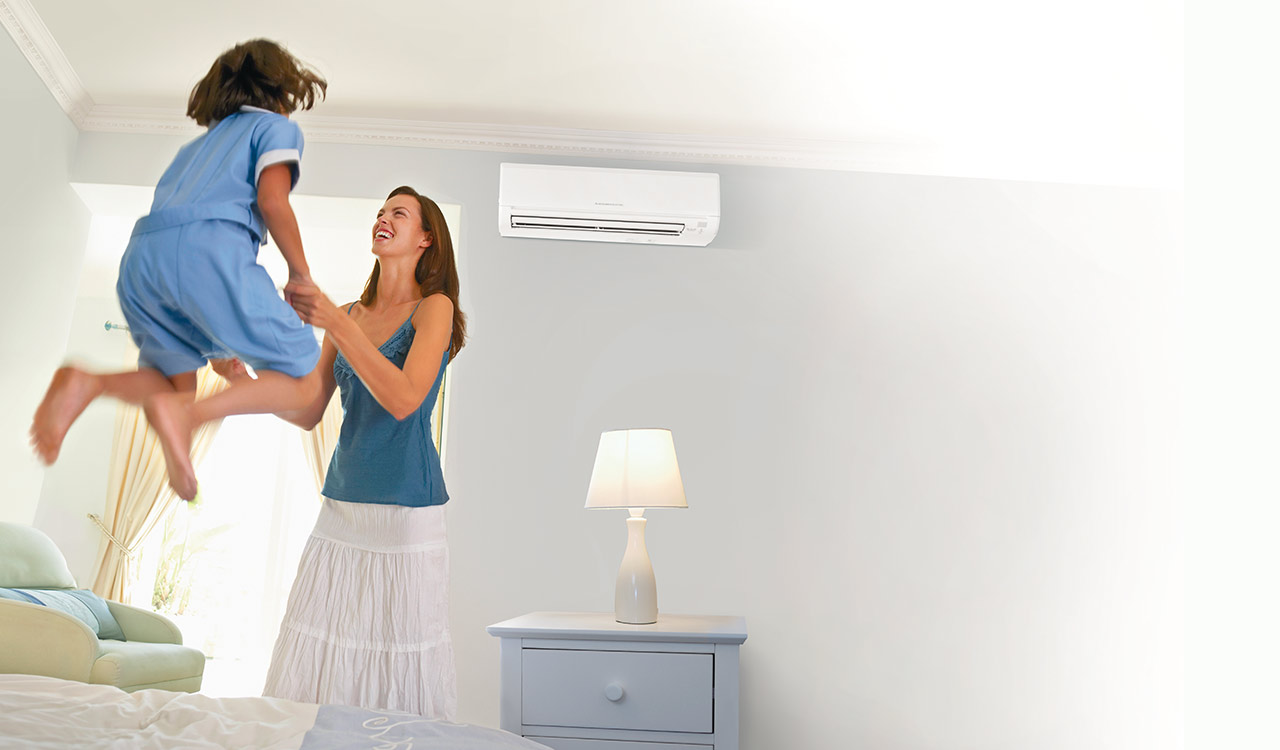 Comfortable home with happy family enjoying Mitsubishi heat pump.